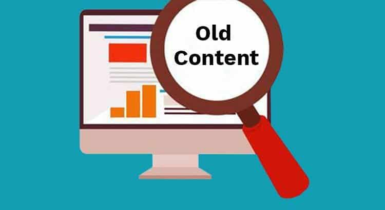 updating website content regularly - magnifying glass highlighting old content over website screen
